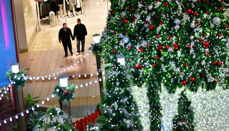 Many Americans plan to spend less this holiday season as