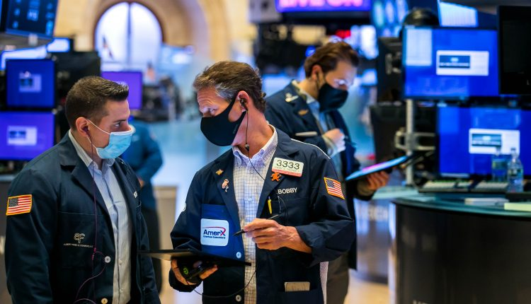 Stock futures modestly lower after major averages close at record