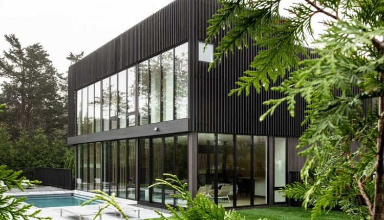 A Sag Harbor Hideaway With Black Slats Creating Privacy +