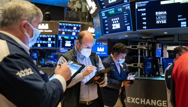 Stock futures little changed after Dow closes at record level