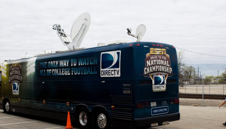 AT&T, loaded with debt from its DirecTV deal, sells part