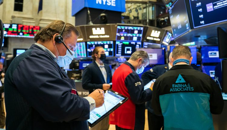 Stock futures are lower after Dow, S&P close at record