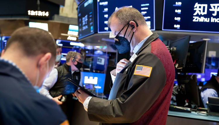 Stock futures are flat after Dow closes at record
