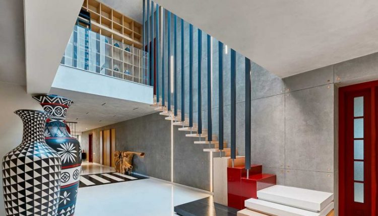 A Neutral Home in Bangalore Comes Alive With Crimson Accents