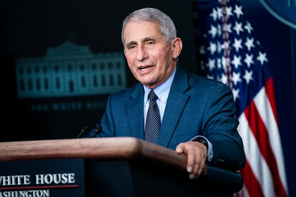Dr. Fauci, Azar receive Moderna's Covid vaccine as rollout begins
