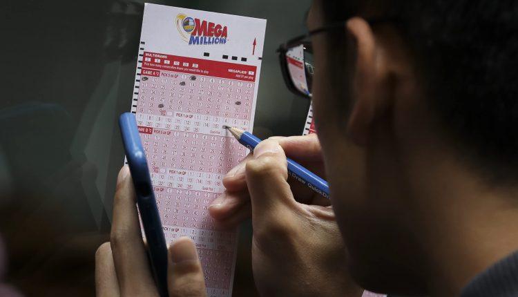 Mega Millions jackpot leaps to $600 million. Here's the tax