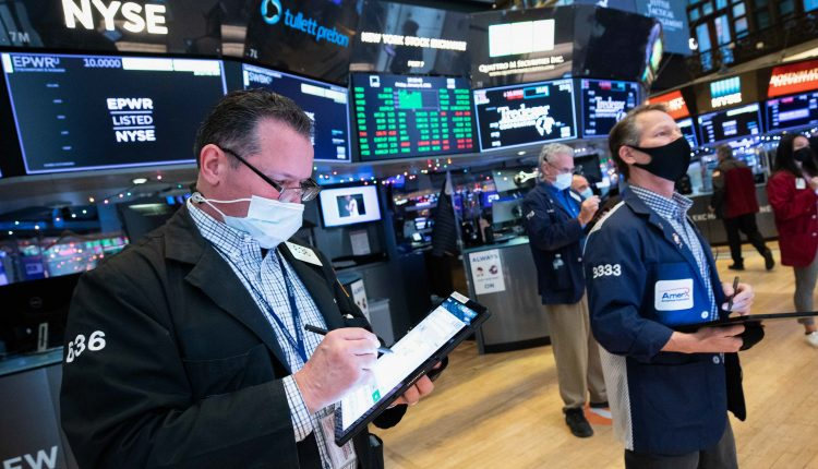 Stock futures fall slightly after Wall Street closed at record
