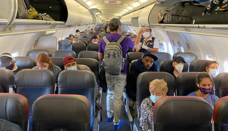 Biden signs order requiring travelers wear masks on planes and