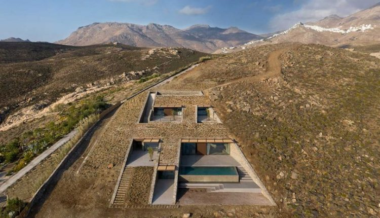 A Cave-Like Home Built into a Rocky Cove Overlooking the