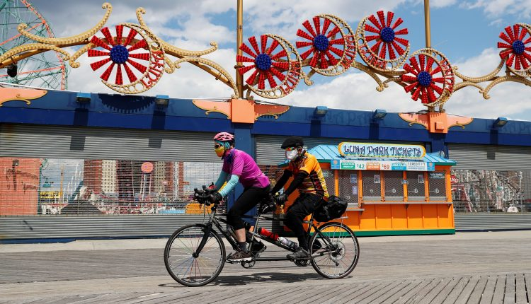New York's Cuomo says amusement parks, summer camps can reopen