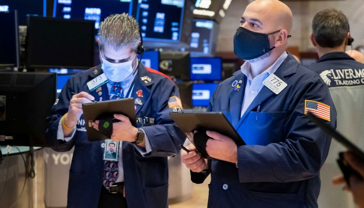 Stock futures modestly lower after Dow closes at record high