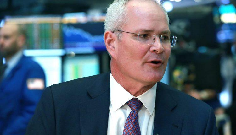 Exxon CEO Darren Woods promises a strong dividend despite 2020
