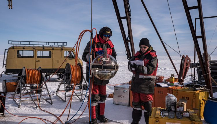 Hunting Ghost Particles Beneath the World's Deepest Lake