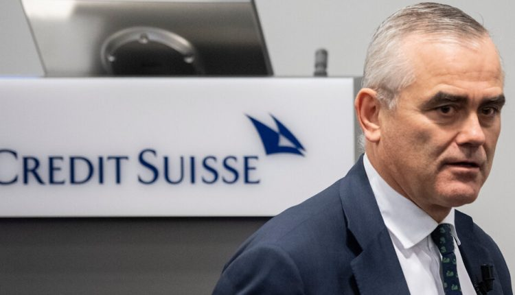 Credit Suisse reports a loss as regulators open an investigation.