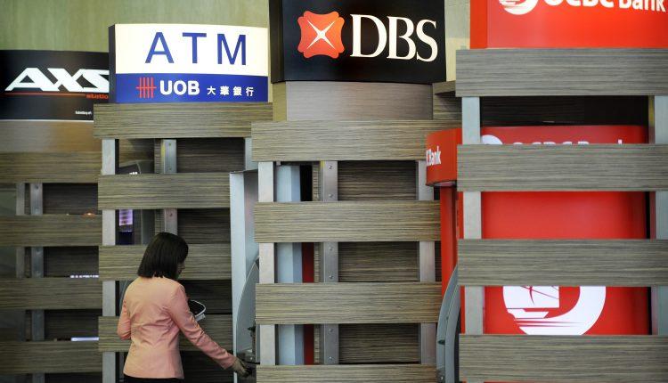 Shares of Singapore banks jump after regulator lifts dividend cap
