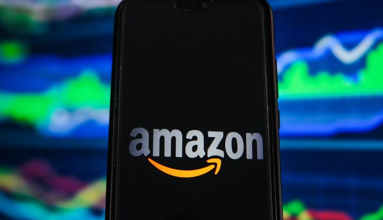 Stocks making the biggest moves midday: Amazon, P&G, Caterpillar, more
