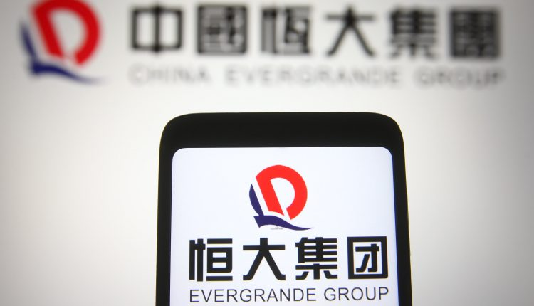 Debt-laden China Evergrande shares drop 14% to four-year lows