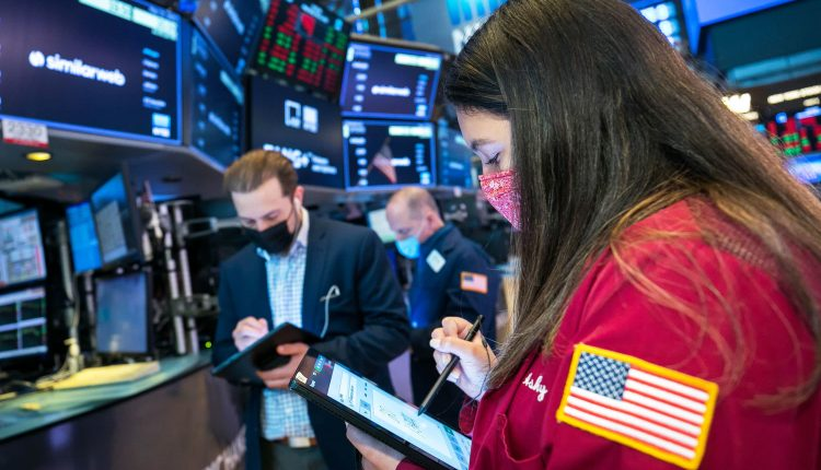 Stock futures are flat as investors await more jobs data