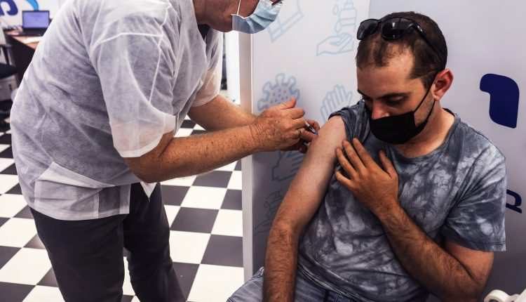 Israel doubles down on Covid booster shots as breakthrough cases