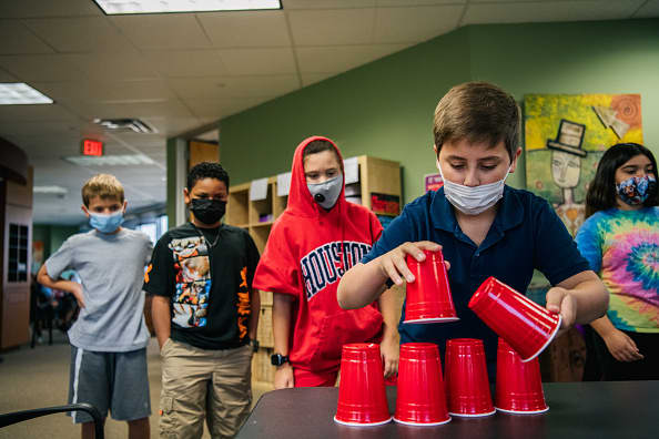 Schools with Covid outbreaks aren't following mask, vaccine guidance