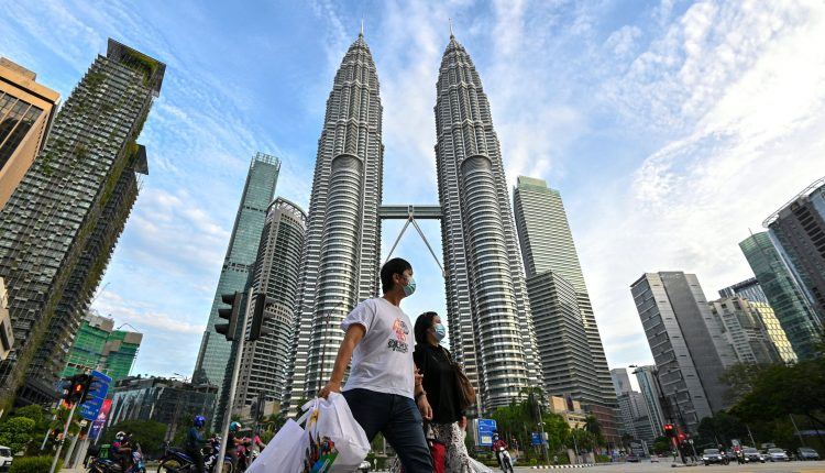 Malaysia to treat Covid as 'endemic' starting end-October: Trade minister